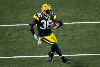 ARLINGTON, TX - FEBRUARY 06:  Nick Collins #36 of the Green Bay Packers runs 37 yards for a touchdown after making an interception in the first quarter against the Pittsburgh Steelers during Super Bowl XLV at Cowboys Stadium on February 6, 2011 in Arlingt