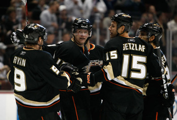 ANAHEIM, CA - NOVEMBER 03:  (L-R) Bobby Ryan #9, Corey Perry #10, Ryan Getzlaf #15  and Scott Niedermayer #27 of the Anaheim Ducks celebrate Perry's first-period goal against the Pittsburgh Penguins at the Honda Center on November 3, 2009 in Anaheim, Cali