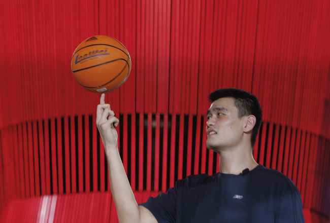 BEIJING, CHINA-AUGUST 21:China's Olympic basketball star Yao Ming shows off some talents along side USA's LeBron James at the Olympic Shuang Zone August 21, 2008 in Beijing. The Shuang Zone, sponsored by Coca Cola allows locals to attend free concerts off