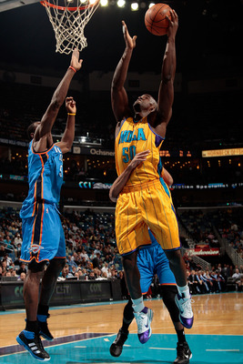NEW ORLEANS, LA - DECEMBER 10:  Emeka Okafor #50 of the New Orleans Hornets shoots the ball over Serge Ibaka #9 of the Oklahoma City Thunder at New Orleans Arena on December 10, 2010 in New Orleans, Louisiana.    NOTE TO USER: User expressly acknowledges