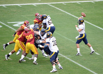 LOS ANGELES, CA - OCTOBER 16:  Kevin Riley #13 of the California Golden Bears passes against the USC Trojans at Los Angeles Memorial Coliseum on October 16, 2010 in Los Angeles, California.  (Photo by Harry How/Getty Images)