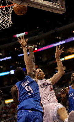 LOS ANGELES, CA - NOVEMBER 03:  Chris Kaman #35 of the Los Angeles Clippers shoots over Serge Ibaka #9 of the Oklahoma City Thunder at Staples Center on November 3, 2010 in Los Angeles, California. The Clippers won 107-92.  NOTE TO USER: User expressly ac