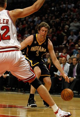 CHICAGO - FEBRUARY 24: Troy Murphy #3 of the Indiana Pacers moves against Brad Miller #52 of the Chicago Bulls at the United Center on February 24, 2010 in Chicago, Illinois. The Bulls defeated the Pacers 120-110. NOTE TO USER: User expressly acknowledges