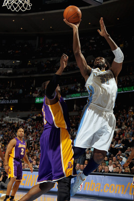 DENVER, CO - JANUARY 21:  Nene #31 of the Denver Nuggets puts up a shot against Andrew Bynum #17 of the Los Angeles Lakers at the Pepsi Center on January 21, 2011 in Denver, Colorado. The Lakers defeated the Nuggets 107-97. NOTE TO USER: User expressly ac