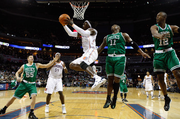 CHARLOTTE, NC - DECEMBER 11:  Glen Davis #11 of the Boston Celtics watches as Gerald Wallace #3 of the Charlotte Bobcats drives to the basket during their game at Time Warner Cable Arena on December 11, 2010 in Charlotte, North Carolina. NOTE TO USER: Use