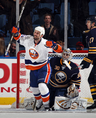 UNIONDALE, NY - JANUARY 23: Radek Martinek #24 of the New York Islanders celebrates a third period goal by teammate Jack Hillen #38 (not shown) against Ryan Miller #30 of the Buffalo Sabres at the Nassau Coliseum on January 23, 2011 in Uniondale, New York