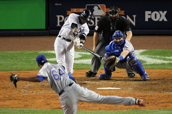 NEW YORK - OCTOBER 20:  Curtis Granderson #14 of the New York Yankees hits a solo home run in the bottom of the eighth inning against Alexi Ogando #64 of the Texas Rangers in Game Five of the ALCS during the 2010 MLB Playoffs at Yankee Stadium on October