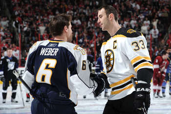 RALEIGH, NC - JANUARY 29:  Zdeno Chara #33 of the Boston Bruins is congratulated by Shea Weber #6 of the Nashville Predators during the Honda NHL SuperSkills competition part of 2011 NHL All-Star Weekend at the RBC Center on January 29, 2011 in Raleigh, N