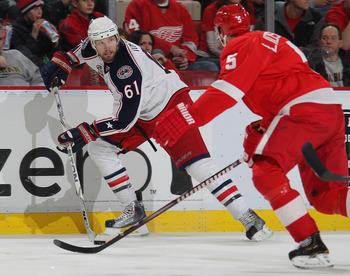 DETROIT, MI - FEBRUARY 4:  Rick Nash #61 of the Columbus Blue Jackets skates away from the checking Nicklas Lidstrom #5 of the Detroit Red Wings in a game on February 4, 2011 at the Joe Louis Arena in Detroit, Michigan. The Blue Jackets defeated the Wings