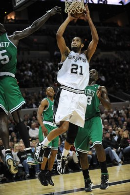 SAN ANTONIO - DECEMBER 03:  Forward Tim Duncan #21 of the San Antonio Spurs takes a shot against Kevin Garnett #5 of the Boston Celtics on December 3, 2009 at AT&T Center in San Antonio, Texas.  NOTE TO USER: User expressly acknowledges and agrees that, b