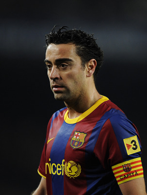 BARCELONA, SPAIN - JANUARY 26:   Xavi Hernandez of Barcelona looks on during the Copa del Rey Semi Final First Leg match between Barcelona and Almeria at Camp Nou on January 26, 2011 in Barcelona, Spain. Barcelona won 5-0.  (Photo by David Ramos/Getty Ima