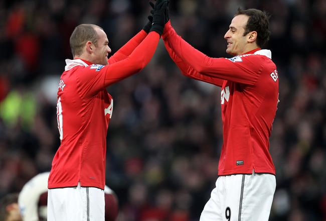 MANCHESTER, ENGLAND - DECEMBER 26:  Dimitar Berbatov of Manchester United celebrates scoring the opening goal with team mate Wayne Rooney (L) during the Barclays Premier League match between Manchester United and Sunderland at Old Trafford on December 26,