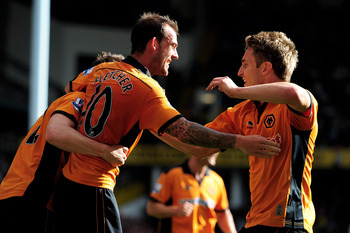 LONDON, ENGLAND - SEPTEMBER 18:  Steven Fletcher (L) of Wolves is congratulated by teammate Kevin Doyle after scoring the opening goal during the Barclays Premier League match between Tottenham Hotspur and Wolverhampton Wanderers at White Hart Lane on Sep