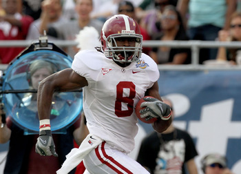 ORLANDO, FL - JANUARY 01:  Julio Jones #8 of the Alabama Crimson Tide rushes for a touchdown during the Capitol One Bowl against the Michigan State Spartans at the Florida Citrus Bowl on January 1, 2011 in Orlando, Florida.  (Photo by Mike Ehrmann/Getty I