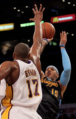 LOS ANGELES, CA - FEBRUARY 28:  Carmelo Anthony #15 of the Denver Nuggets shoots over Andrew Bynum #17 of the Los Angeles Lakers during the second half at Staples Center on February 28, 2010 in Los Angeles, California. The Lakers defeated the Nuggets 95-8
