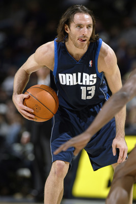 DENVER - DECEMBER 18:  Steve Nash #13 of the Dallas Mavericks holds the ball during the game against the Denver Nuggets at Pepsi Center on December 18, 2002 in Denver, Colorado.  The Mavs won 80-75.   NOTE TO USER: User expressly acknowledges and agrees t