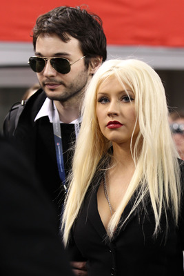 ARLINGTON, TX - FEBRUARY 06:  Singer Christina Aguilera (R) and Matthew Rutler attend the Bridgestone Super Bowl XLV Pregame Show at Dallas Cowboys Stadium on February 6, 2011 in Arlington, Texas.  (Photo by Christopher Polk/Getty Images)