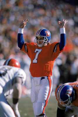 DENVER - JANUARY 17:  Quarterback John Elway #7 of the Denver Broncos calls a play at the line of scrimmage during the 1987 AFC Championship game against the Cleveland Browns at Mile High Stadium on January 17, 1988 in Denver, Colorado.  The Broncos won 3