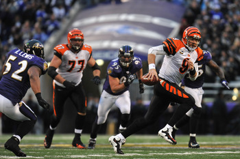 BALTIMORE, MD - JANUARY 2:  Carson Palmer #9 of the Cincinnati Bengals runs the ball before fumbling with less than two  minutes to go in the game against the Baltimore Ravens at M&T Bank Stadium on January 2, 2011 in Baltimore, Maryland. The Ravens defea
