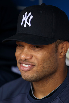 ARLINGTON, TX - OCTOBER 22:  Robinson Cano #24 of the New York Yankees sits in the dugout prior to playing the Texas Rangers in Game Six of the ALCS during the 2010 MLB Playoffs at Rangers Ballpark in Arlington on October 22, 2010 in Arlington, Texas.  (P