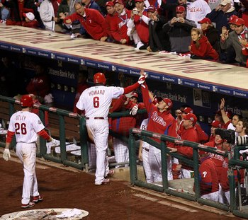 PHILADELPHIA - OCTOBER 26:  Ryan Howard #6 of the Philadelphia Phillies celebrates with teammates in the dugout after he hit a 2-run home run which also scored Chase Utley #26 in the bottom of the eighth inning against the Tampa Bay Rays looks on during g
