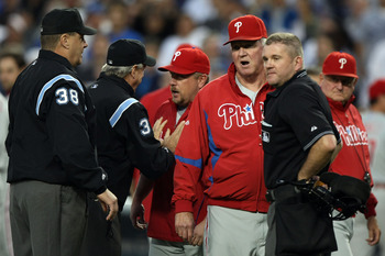 LOS ANGELES, CA - OCTOBER 12:  The umpires talk to manager (M) Charlie Manuel after the benches cleared in the third inning against the Los Angeles Dodgers in Game Three of the National League Championship Series during the 2008 MLB playoffs on October 12