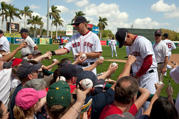 FORT MYERS, FL - MARCH 13:  Infielder Lars Anderson #78 of the Boston Red Sox signs some autographs just prior to the start of the Grapefruit League Spring Training Game against the Pittsburgh Pirates at City of Palms Park on March 13, 2010 in Fort Myers,
