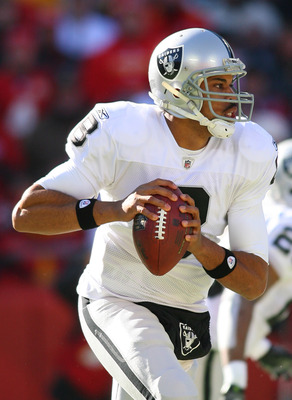 KANSAS CITY, MO - JANUARY 02:  Quarterback Jason Campbell #8 of the Oakland Raiders scrambles in a game against the Kansas City Chiefs at Arrowhead Stadium on January 2, 2011 in Kansas City, Missouri.  (Photo by Tim Umphrey/Getty Images)