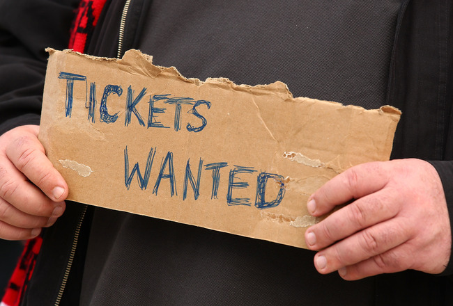 MELBOURNE, AUSTRALIA - SEPTEMBER 25:  A football fan holds a sign requesting match tickets prior to the AFL Grand Final match between the Collingwood Magpies and the St Kilda Saints at Melbourne Cricket Ground on September 25, 2010 in Melbourne, Australia