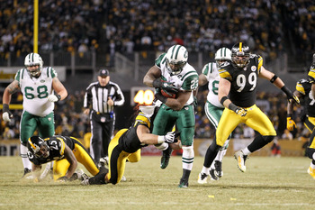 PITTSBURGH, PA - JANUARY 23:  Shonn Greene #23 of the New York Jets runs down field against the Pittsburgh Steelers during the 2011 AFC Championship game at Heinz Field on January 23, 2011 in Pittsburgh, Pennsylvania.  (Photo by Ronald Martinez/Getty Imag