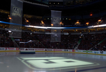 VANCOUVER, CANADA - DECEMBER 11: The number 19 of Markus Naslund formerly of the of the Vancouver Canucks is projected on the ice during a ceremony to retire his jersey prior to NHL action against the Tampa Bay Lightning on December 11, 2010 at Rogers Are