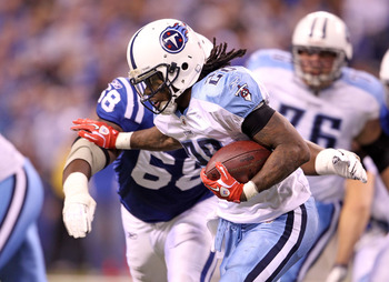 INDIANAPOLIS - JANUARY 02:  Chris Johnson #28 of the Tennessee Titans is tackled by Eric Foster #68 of the Indianapolis Colts at Lucas Oil Stadium on January 2, 2011 in Indianapolis, Indiana.  the Colts won 23-20.  (Photo by Andy Lyons/Getty Images)