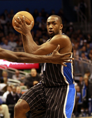 ORLANDO, FL - FEBRUARY 03:Guard Gilbert Arenas #1 of the Orlando Magic drives against the Miami Heat at Amway Arena on February 3, 2011 in Orlando, Florida. NOTE TO USER: User expressly acknowledges and agrees that, by downloading and/or using this Photog