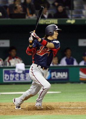 TOKYO, JAPAN - MARCH 4: Infielder Tsuyoshi Nishioka #7 of Japan watches the ball after hitting during the first round of the 2006 World Baseball Classic at the Tokyo Dome on March 4, 2006 in Tokyo, Japan. (Photo by Koichi Kamoshida/Getty Images)