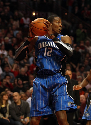 CHICAGO, IL - JANUARY 28: Dwight Howard #12 of the Orlando Magic grabs a rebound against the Chicago Bulls at the United Center on January 28, 2011 in Chicago, Illinois. The Bulls defeated the Magic 99-90. NOTE TO USER: User expressly acknowledges and agr