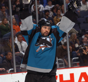 WASHINGTON, D.C. - NOVEMBER 19:  Right wing Owen Nolan #11 of the San Jose Sharks celebrates a goal against the Washington Capitals during the NHL game at the MCI Center on November 19, 2002 in Washington D.C.  The Sharks won 3-2.  (Photo by Doug Pensinge