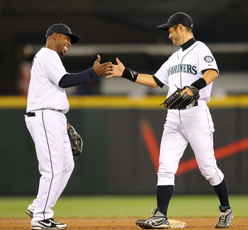 SEATTLE - MAY 26:  Ichiro Suzuki #51 (R) of the Seattle Mariners celebrates with Chone Figgins #9 after defeating the Detroit Tigers 5-4 at Safeco Field on May 26, 2010 in Seattle, Washington. (Photo by Otto Greule Jr/Getty Images)