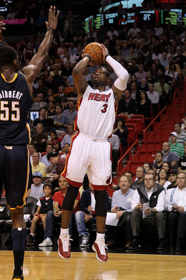 MIAMI, FL - FEBRUARY 08:  Dwyane Wade #3 of the Miami Heat shoots a jumper during a game against the Indiana Pacers at American Airlines Arena on February 8, 2011 in Miami, Florida. NOTE TO USER: User expressly acknowledges and agrees that, by downloading