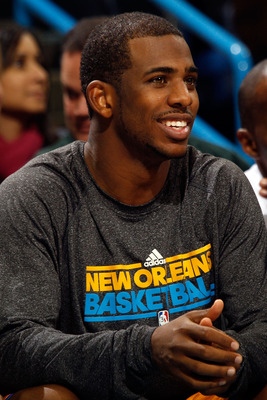 NEW ORLEANS, LA - JANUARY 22:  Chris Paul #3 of the New Orleans Hornets watches the end of the game against the San Antonio Spurs at the New Orleans Arena on January 22, 2011 in New Orleans, Louisiana.  The Hornets defeated the Spurs 96-72.  NOTE TO USER: