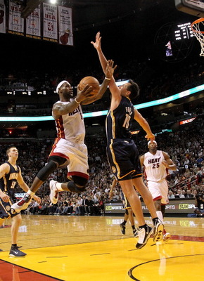 MIAMI, FL - FEBRUARY 08:  LeBron James #6 of the Miami Heat shoots over Jeff Foster #10 of the Indiana Pacers during a game at American Airlines Arena on February 8, 2011 in Miami, Florida. NOTE TO USER: User expressly acknowledges and agrees that, by dow