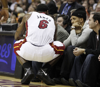 CLEVELAND, OH - DECEMBER 02:  LeBron James #6 of the Miami Heat talks with Maverick Carter while playing the Cleveland Cavaliers at Quicken Loans Arena on December 2, 2010 in Cleveland, Ohio. NOTE TO USER: User expressly acknowledges and agrees that, by d