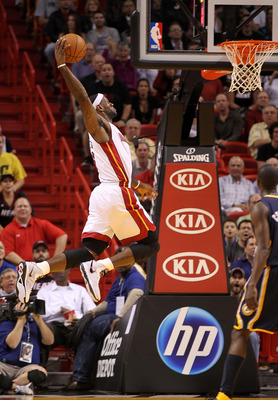 MIAMI, FL - FEBRUARY 08: LeBron James #6 of the Miami Heat dunks during a game against the Indiana Pacers at American Airlines Arena on February 8, 2011 in Miami, Florida. NOTE TO USER: User expressly acknowledges and agrees that, by downloading and/or us