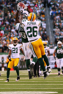 EAST RUTHERFORD, NJ - OCTOBER 31:  Charlie Peprah #26 of the Green Bay Packers keeps Jerricho Cotchery #89 of the New York Jets from catching a pass during the fourth quarter on October 31, 2010 at the New Meadowlands Stadium in East Rutherford, New Jerse