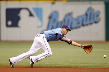 ST. PETERSBURG - AUGUST 01:  Infielder Reid Brignac #15 of the Tampa Bay Rays dives for a ball against the New York Yankees during the game at Tropicana Field on August 1, 2010 in St. Petersburg, Florida.  (Photo by J. Meric/Getty Images)