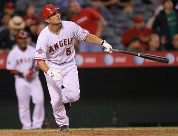 ANAHEIM, CA - SEPTEMBER 08:  Jeff Mathis #5 of the Los Angeles Angels of Anaheim hits a walk off sacrifice fly to score Torii Hunter from third base against the Cleveland Indians in the 16th inning on September 8, 2010 at Angel Stadium in Anaheim, Califor