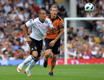 LONDON, ENGLAND - SEPTEMBER 11:  Bobby Zamora (L) of Fulham in action with Christophe Berra of Wolverhampton Wanderers during the Barclays Premier League match between Fulham and Wolverhampton Wanderers at Craven Cottage on September 11, 2010 in London, E