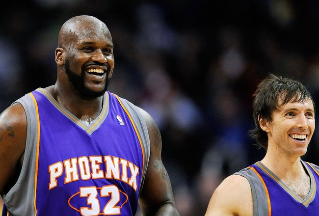 LOS ANGELES, CA - FEBRUARY 18:  Shaquille O'Neal #32 of the Phoenix Suns is congratualted by his teammate Steve Nash #13 and Grant Hill #33 during the basketball game against the Los Angeles Clippers during the second quarter at the Staples Center on Febr