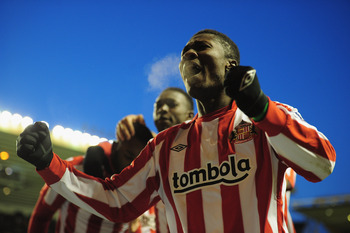 WOLVERHAMPTON, ENGLAND - NOVEMBER 27:  Asamoah Gyan of Sunderland celebrates after team-mate Darren Bent scores during the Barclays Premier League match between Wolverhampton Wanderers and Sunderland at Molineux on November 27, 2010 in Wolverhampton, Engl