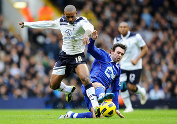 LONDON, ENGLAND - FEBRUARY 05:  Mark Davies of Bolton Wanderers tackles Jermain Defoe of Tottenham Hotspur during the Barclays Premier League match between Tottenham Hotspur and Bolton Wanderers at White Hart Lane on February 5, 2011 in London, England.
