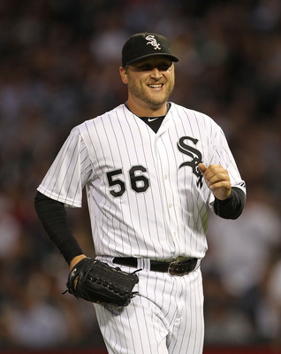 CHICAGO - AUGUST 25: Mark Buehrle #56 of the Chicago White Sox smiles as he leaves the field during a game against the Baltimore Orioles at U.S. Cellular Field on August 25, 2010 in Chicago, Illinois. The Orioles defeated the White Sox 4-2. (Photo by Jona
